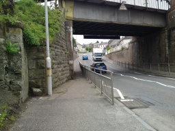 The gradient of the footway up from the dip under the bridge to Station Head Road is about 7% (1:15) for about 50m.