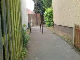 There is a staggered barrier with a gap 80cm wide.