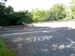 Turn right on the B981 (Lisa Brae), there is no dropped kerb to the footway. This is a very fast, busy road. Take Care!
