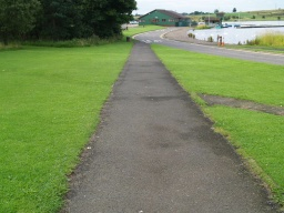 The path is wide enough for two people to walk side by side throughout its length.