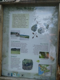 There is a sign that gives information about what is to be seen in the the country park and from its trails.