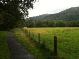 The path has pleasant veiws of the surrounding Luss Hills.
