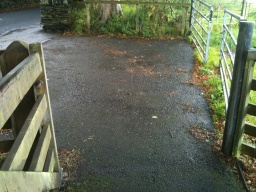 Go through the wicket gate and head onto the pavement.