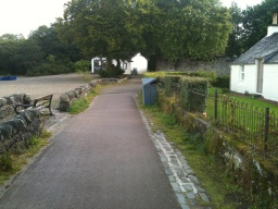 Turn Right past the white cottage.