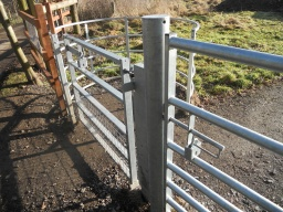 The field-gate (for vehicular access) is also operated with a slide latch and opened with a  RADAR key.