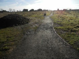 There is some loose surface material at the start of the path.
