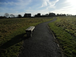 The bench is set on the hard-surface of the path, allowing easy access. The path width is 2 metres at this point.
