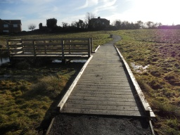 The width of the boardwalk  is 1.5 metres. There is a minor step level rise leading form the path.
