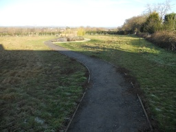The path meanders toward the sensory garden area.