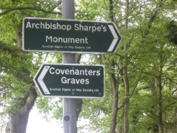 The path splits and there is a rough path that leads to a kissing gate, beyond the gate there is a clearance in a field which leads to the Covenanters Grave and the other path leads to the Archbishop Sharpe's Monument