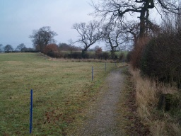 The path is about 1m wide along most of its length which may not be quite wide enough for two people to walk side by side.