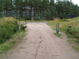 The main track reaches the road just above the Haymeadow car park