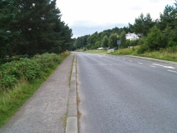 As the footway begins the visitor centre can be seen 150m away on the other side of the road.