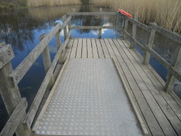 Ramped access to the end of the dipping platform.