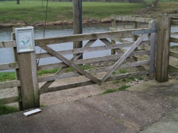 The entrance gate to the circular path is over 2m wide with a latch that can be reached from both side at about 700mm above the ground.