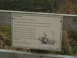 There are signs explaining the farming methods used on this particular farm.