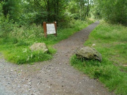 The start of the walk is between two boulders by the information sign some 50 yards from the car park.