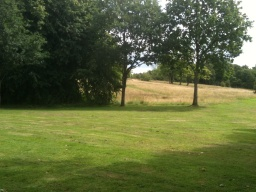 There is a wide grassed area in front of Plean House