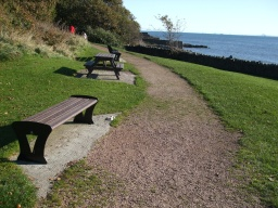Seats and a picnic bench allow you to rest and admire the views out to sea.