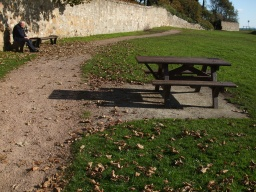 Another picnic table and benches are available in this sheltered spot.