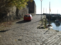 Follow the cobbled path right round the harbour.