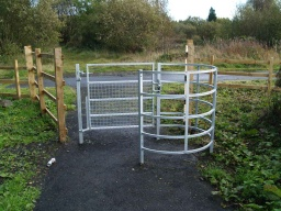 The approximate dimensions of the kissing gate are width 85cm and depth 75cm. The latch is about 85cm from the ground