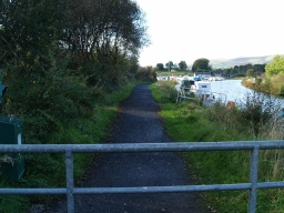 There is a field gate across the path with a chicane next to it.