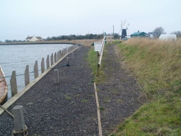 The path to the moorings has a gentle slope (less than 7% (1:14). It is less than 1.2 wide with loose stone and gravel on its surface.