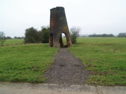 The remains of an old windmill can be reached from the track by a short path of loose stone and gravel.