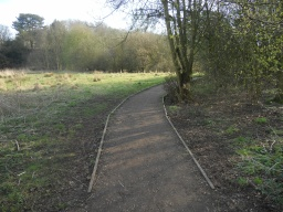 A raised section of path has been constructed over an area which is liable to become muddy.