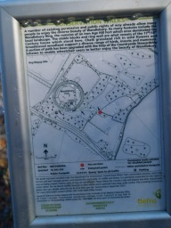 There is a sign and map providing information about the paths in the area.