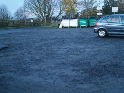 The car park has a crushed stone surface.