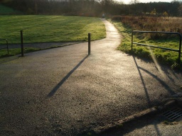 The path towards the cycleway from Lindsay's Wynd, Oakley. There is a 12% (1:8) gradient near the bollard.