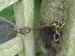 The latch is a hook and chain which may not be as easy to reach from the far side.
