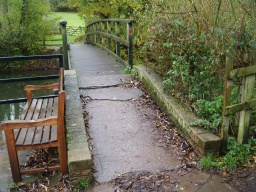 The slopes on and off the arched bridge over the mill pond have gradients of about 19% (1:5) for approximately 3m but there are also little steps in the concrete that might be difficult for some people.