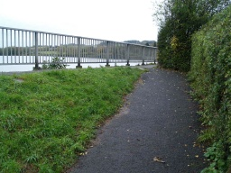 The top of the ramp reaches the dam path which is level.
