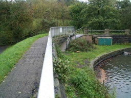 The dam path is of tarmac and leads to the stone path that runs along the south side of the reservoir.